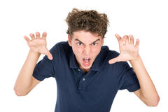 Teen faces. Angry teenage boy making faces isolated in white Royalty Free Stock Photo
