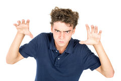 Teen faces. Angry teenage boy making faces isolated in white Royalty Free Stock Image