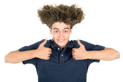 Teen faces. Happy teenager boy making faces with crazy hair isolated in white Stock Photos