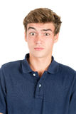 Teen faces. Surprised teenage boy making faces isolated in white Stock Photo