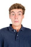 Teen faces. Surprised teenage boy making faces isolated in white Stock Photography