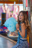 Teen at fair eating candy floss or cotton. Royalty Free Stock Images