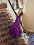 Teen in Fancy Gown. A portrait of a pretty teenage girl standing on steps in a long, elegant gown Royalty Free Stock Photos