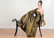Teen in fancy green dress relaxing Royalty Free Stock Photos