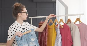 Teen fashion designer presenting new outfit collection stock video