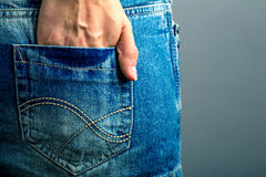 Teen fashion, hand of a girl in a pocket of a denim skirt. Teen fashion, hand of a girl in a pocket of a denim mini skirt Stock Photo