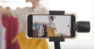 Fashion vlogger recording new video on mobile phone