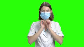 Teen female doctor wearing medical protective mask.