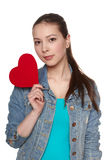 Teen female with heart. Against white background stock photography