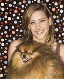 Teen female holding dog. Caucasian teen female holding Pomeranian dog Stock Images