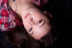 Teen female laying down Stock Photo