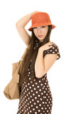 Teen female model wearing an orange hat and brown polka dot dre Royalty Free Stock Photography