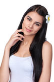 Teen female with Plumeria Flower Stock Images