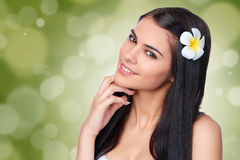 Teen female with Plumeria Flower Royalty Free Stock Image