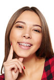 Teen female smiling with braces on her teeth Stock Photos