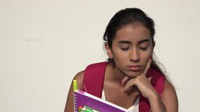 Teen Female Student Thinking. A young female hispanic teen stock footage