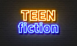 Teen fiction neon sign on brick wall background. Teen fiction neon sign on brick wall background Royalty Free Stock Photos