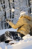 Teen fighting with snow balls Royalty Free Stock Image