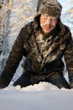 Teen fighting with snowballs Stock Photos