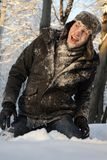 Teen fighting with snowballs Stock Photography