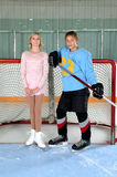 Teen Figure Skater Hockey Player Couple. A Teenage Winter Sport Couple at Hockey Arena Figure Skater and Hockey Player stock photo