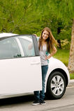 Teen First Car. Teen girl happy with her first car Stock Images