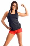 Teen fitness. Teen model wearing fitness outfit shows off her muscle pose Stock Photo