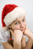 Teen flicka i den Santa hatten Arkivbild