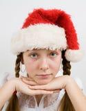 Teen flicka i den Santa hatten Fotografering för Bildbyråer
