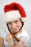 Teen flicka i den Santa hatten Royaltyfri Bild