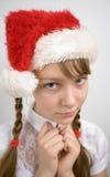 Teen flicka i den Santa hatten Arkivbilder