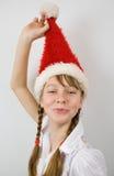 Teen flicka i den Santa hatten Royaltyfri Foto