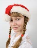 Teen flicka i den Santa hatten Royaltyfri Fotografi