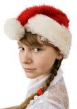 Teen flicka i den Santa hatten Arkivfoton