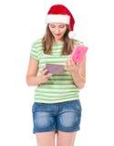 Teen flicka i den Santa hatten Arkivfoto