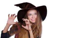 Teen flicka som slitage den halloween häxadräkten Royaltyfri Bild