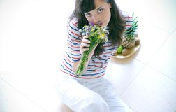 Teen with flowers Royalty Free Stock Images