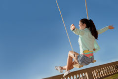 Teen freedom. Girl on swing in summer Royalty Free Stock Images