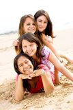 Teen friends. Group of teen girl friends playing on beach Stock Photos