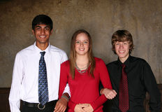 Teen friends. Diverse teens in formal dress smiling in studio Stock Photo