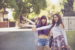 Teen friends, Hitch hike in the streets Stock Image