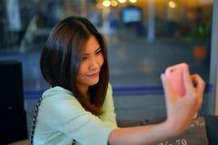 Teen friends taking photos Stock Image