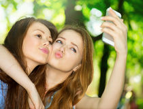 Teen friends taking photos royalty free stock image