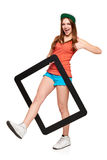 Teen funky girl standing with a frame Royalty Free Stock Photo