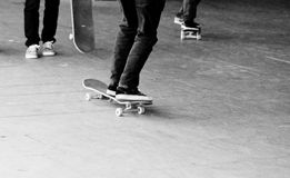 Teen gang group friends on skateboard Royalty Free Stock Photo