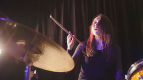 Teen garage rock music - attractive girl percussion drummer perform music break down. Horizontal Stock Image