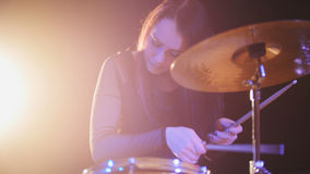 Teen garage rock music - attractive girl percussion drummer perform music break down. Horizontal Stock Photography