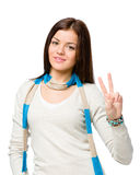 Teen gesturing victory sign Stock Images