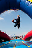 Teen Gets Airborne Attempting To Dunk Basketball In Carnival Game Royalty Free Stock Photo