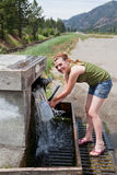 Teen Getting Spring Water Royalty Free Stock Images